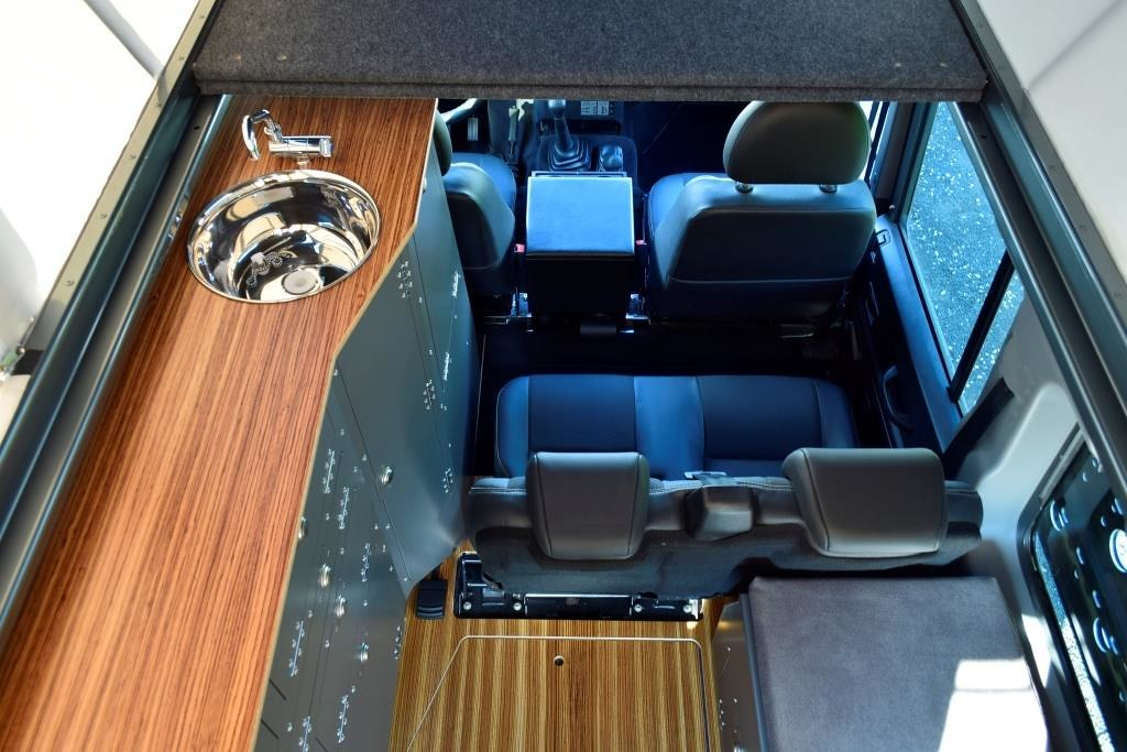 Looking down at a four-seat Ex-Tec Land Rover Defender interior
