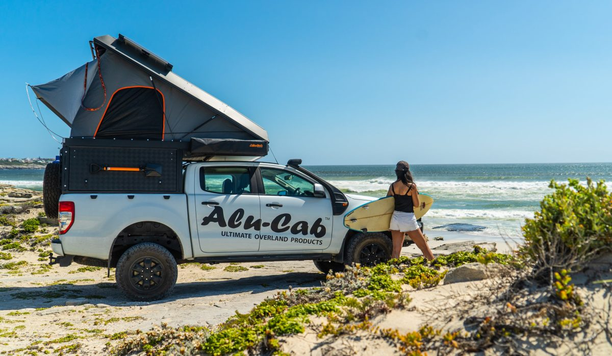 The Alu-Cab Canopy Camper's roof and walls can be used to carry gear