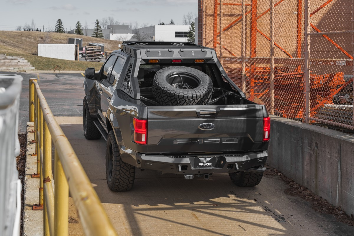 The spare tire carrier is sized around the oversized off-road tires