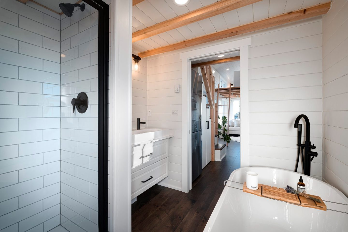 The 34ft Eco-Friendly Tiny House RV's bathroom includes a shower, bathtub, sink, and composting toilet