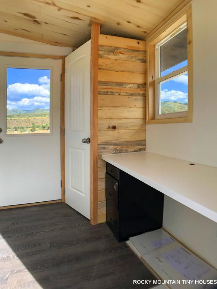 The City of Aspen Carpool Kiosk includes a desk area and a small bathroom with toilet and storage space (not pictured)