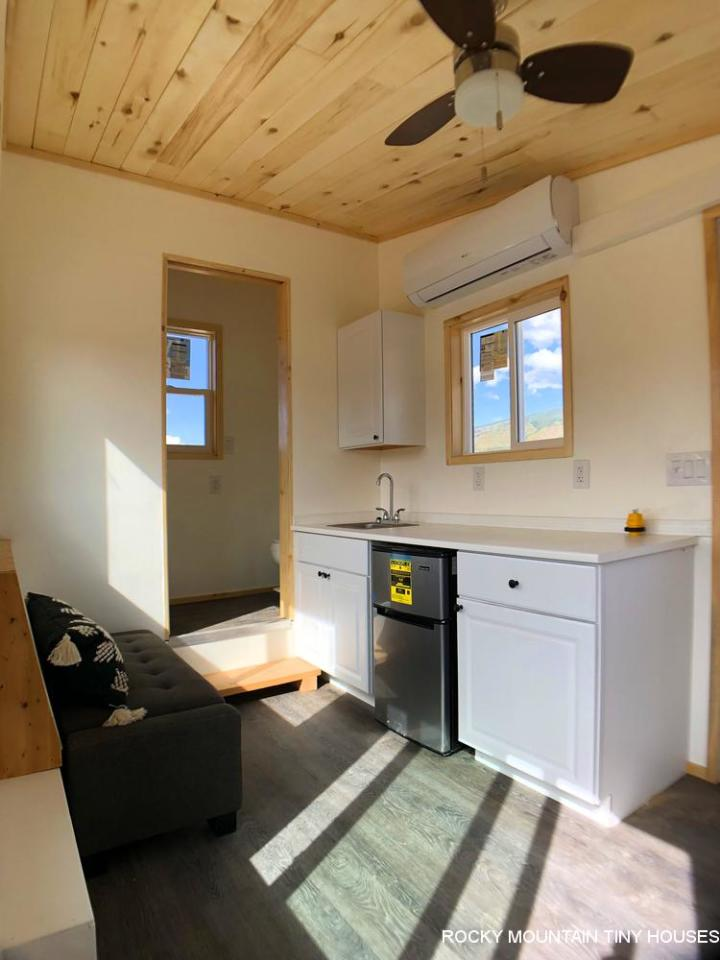 The City of Aspen Carpool Kiosk includes a basic kitchenette with a sink, fridge, some cabinetry, a microwave, and a coffee maker