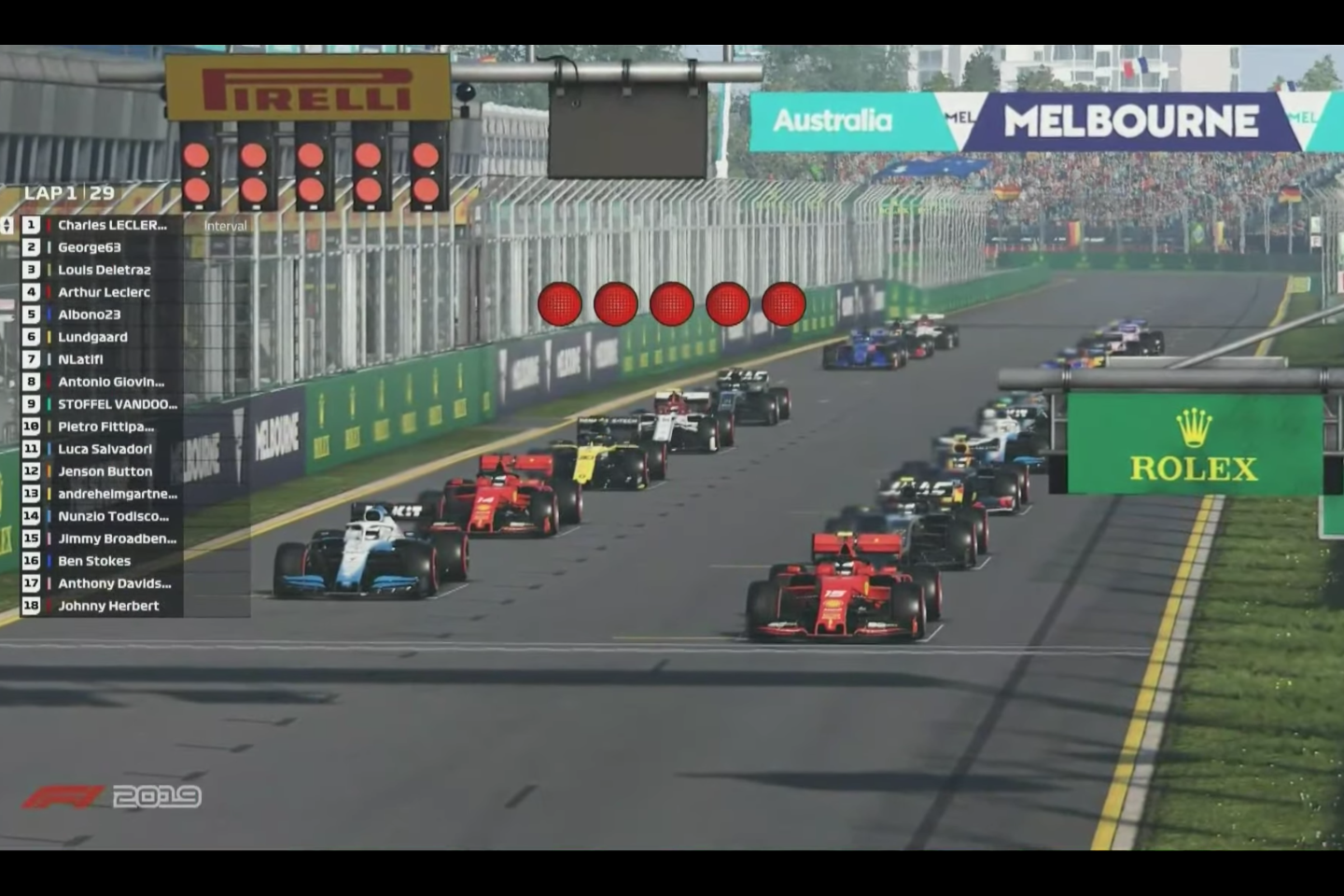 Virtually indistinguishable from the real deal on television, other than the names. That's Charles Leclerc's Ferrari on pole, George63 is George Russell in the Williams, Louis Delétraz is a Swiss Formula 2 driver, Arthur Leclerc is an ADAC F4 chamdriver, Charles' younger brother and a Ferrari Academy driver, Albono23 is Red Bull Racing's Alexander Albon, Lundgaard is Formula 2 driver Christian Lundgaard, NLatifi is Williams F1 driver Nicholas Latifi, Antonio Giovinazzi is an Alfa Romeo F1 driver and Stoffel Vandoorne is a Mercedes driver in Formula E. Other notables in the field are former world F1 champ Jenson Button, British cricketer Ben Stokes and former F1 star and commentator Johnny Herbert