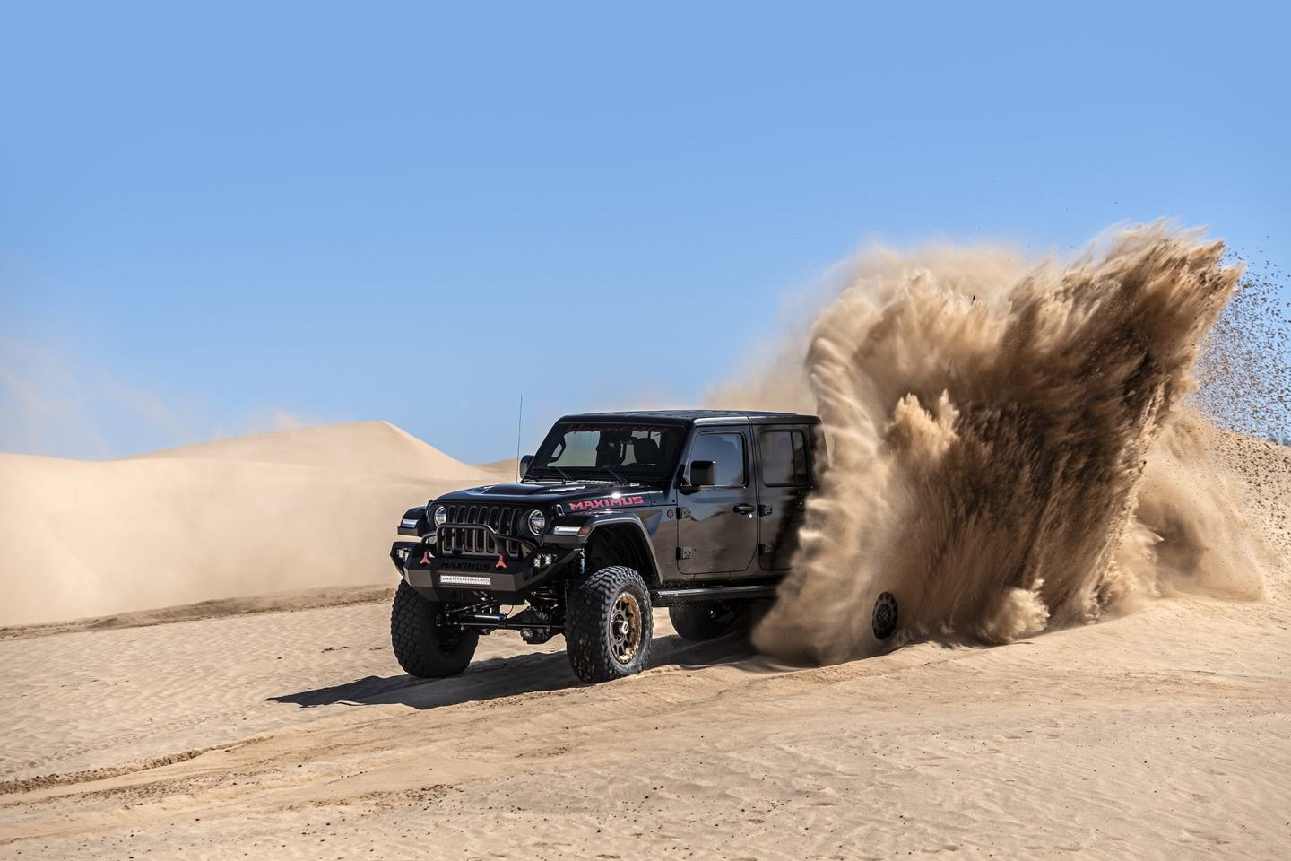 With 1,000 hp and 933 lb-ft, the Maximus muscles its way through the shifty sand