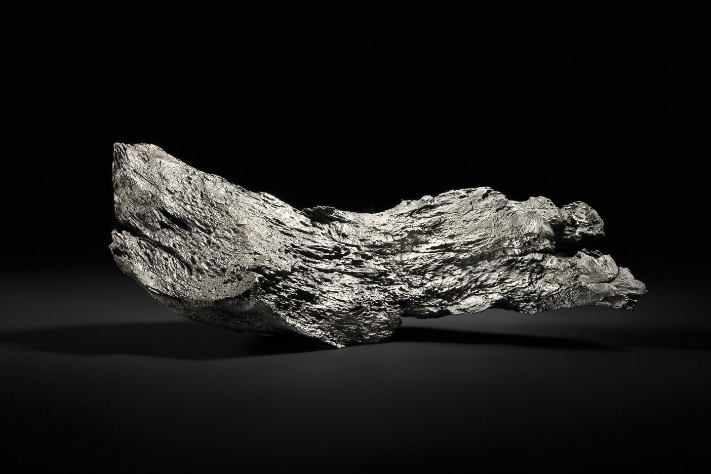 This 19.7kg Dronino Meteorite comes from the Ryazan district of Russia, and displays the wavy, textured, surface that is unique to Dronino meteorites, resulting from the centuries-long interaction of this meteorite's unique chemical composition with that of the ground. Unmounted, the meteorite balances stably on a flat surface and measures 17 x 7 x 61⁄4 inches (43.5 x 18 x 16 cm)