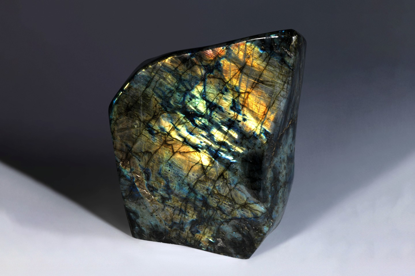 This free-form specimen of Labradorite is polished on all sides and measures 13 x 9 x 4 inches (33 x 23 x 10cm)