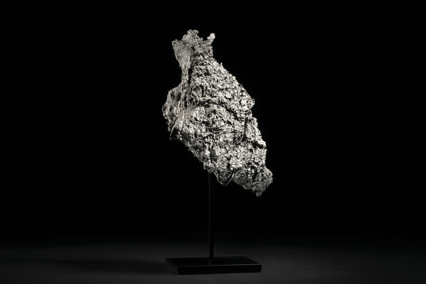 Named after the small Russian town situated close to its discovery site, Dronino meteorites are iron-rich meteorites boasting an exotic chemical composition. This specimen measures 91⁄4 x 43⁄4 x 41⁄2 inches (24 x 12.5 x 12 cm) and weighs 5.4 kg