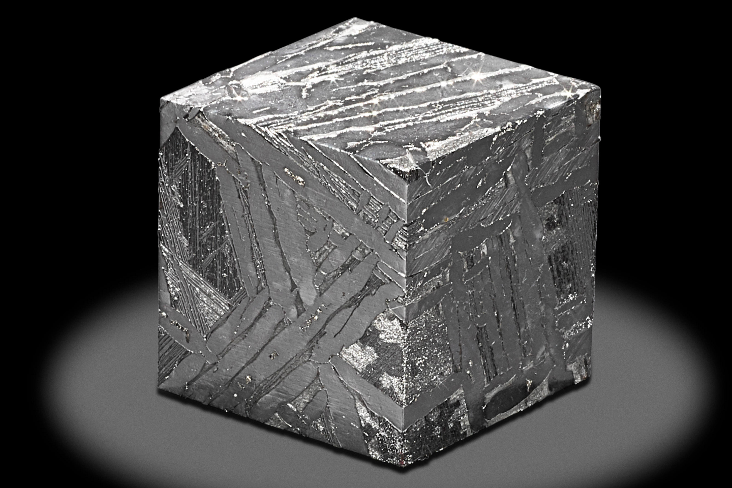 This 3.0 x 3.0 x 3.0 cm cube was cut from the Seymchan meteorite. It weighs 223.9 grams and has an estimate of US$2,200 to $2,800.