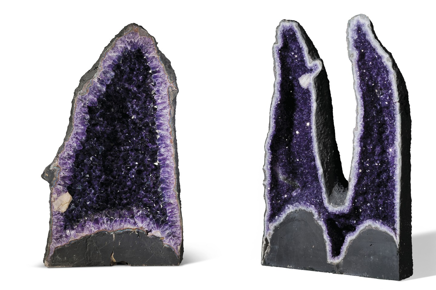 Amethyst Geodes are far from rare, and can be found all over the world within volcanic rocks, though large and beautiful examples command a premium. These two examples are both from the Rio Grande Do Sul region of Brazil, one of the world's most abundant resources of amethyst. They stand 31 inches (78.5 cm) and 34 inches (87 cm) tall respectively.