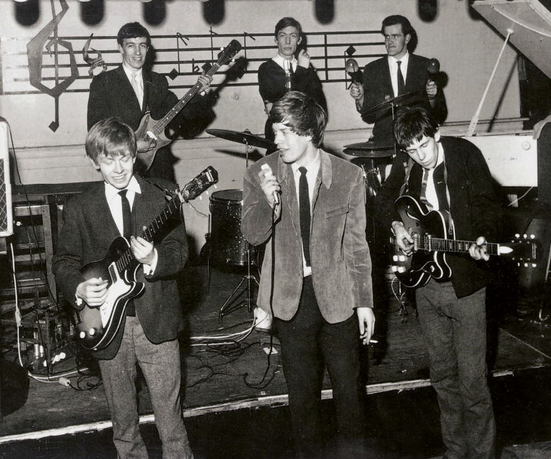 Brian Jones playing this 1960 Harmony Stratotone on stage with the Rolling Stones' first line up at the Marquee Club, Oxford Street, London in 1963. They certainly look like a bunch of clean cut lads these days but their long hair at the time was quite outrageous