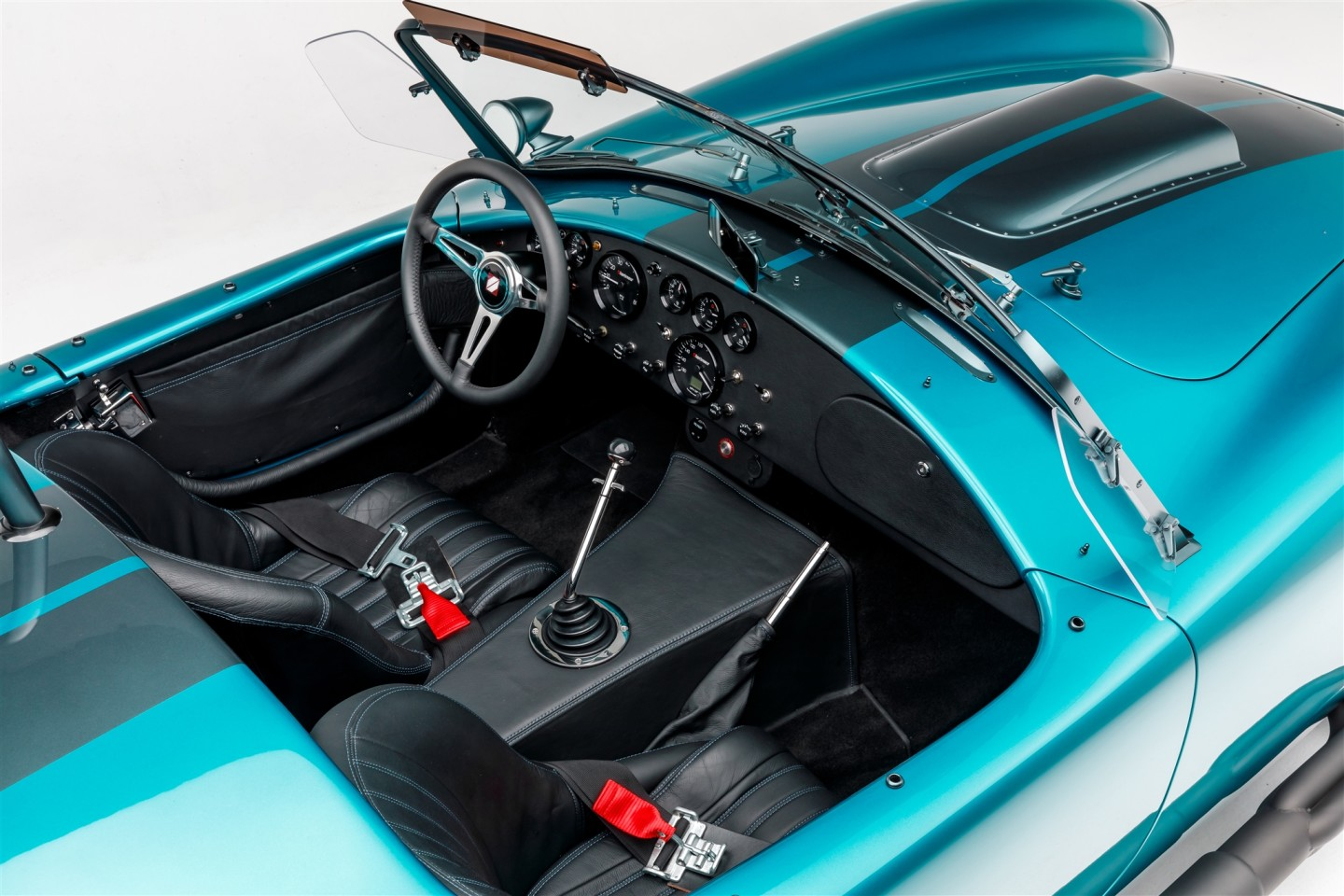 The interior receives some body-matched stitching, electronic gauges and added leather