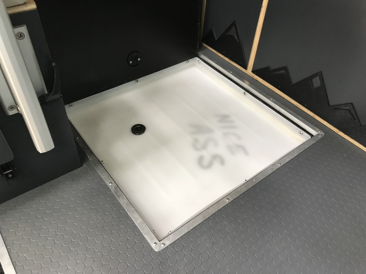 Lift away the access panel and reveal the shower floor
