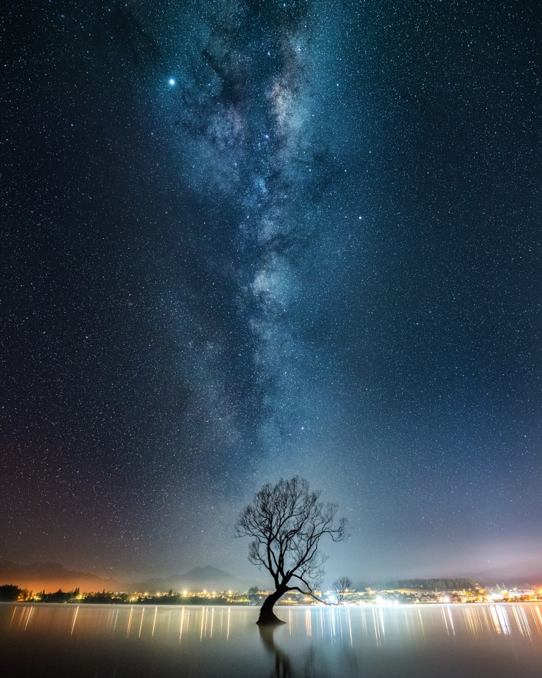 Astro division finalist: Milky Way over the Wanaka TreeWhen I arrived at this location near midnight, I was the only one there. It was quite a contrast compared to the normal flow of photographers during the day. I stacked together 15 images, each one being a 4 second exposure. Camera: Alpha 7R III Lens: FE 16-35mm F2.8 GM Focal length: 16mm Shutter speed: 4s Aperture: ƒ/4 ISO: 12800