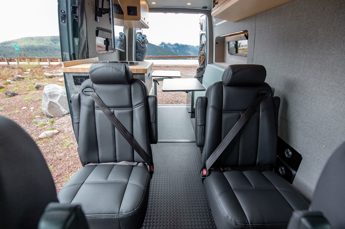 The rear captain's chairs provide a more comfortable ride than the benches seen in many camper vans