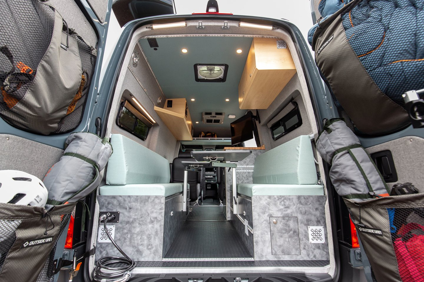 The Blue Sky van's flexible rear space converts from dining lounge to bunk beds