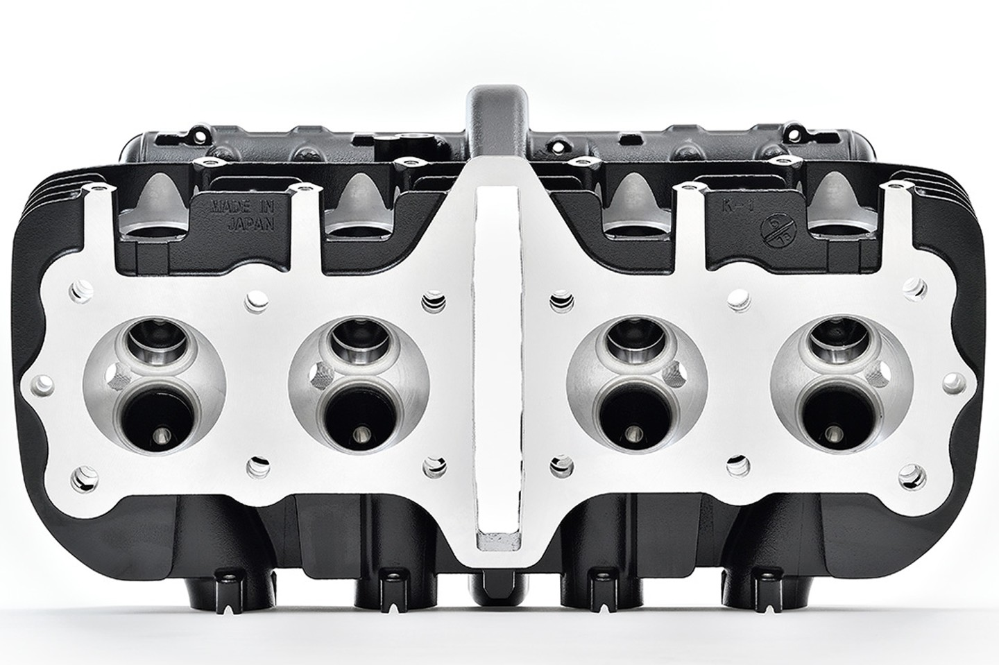 "Kawasaki's reproduction Z1 cylinder heads will sell for US$2370, including camshaft brackets, tappers, valves and peripheral parts, but not including camshafts, cylinder head cover, gaskets, etc. The heads feature the M8 exhaust-pipe-attachment stud bolt dimensions from later Z1 models, and do not fit the second-generation Kawasaki KZ1000 MKII and other so-called ""square head"" models."