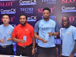 Photo release shows Nnamdi Ezeigbo, Managing Director & CEO, SLOT of Nigeria, second from left, when Teno, official partner of Manchester City Football Club, held a press conference with Nigerian mobile phone retail chain outlet, SLOT, announcing the exclusive sales of the Camon CX Manchester City Limited Edition at all SLOT outlets in Nigeria.