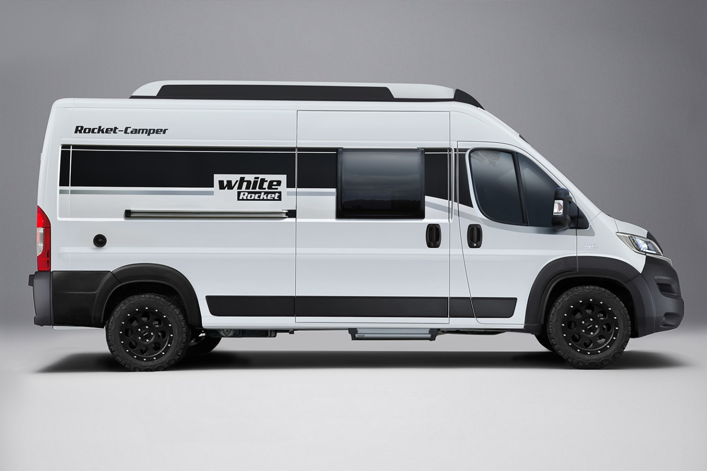 The White Rocket includes the Rocket Roof and the Rocket Mountain Package with suspension lift and upgraded wheels/all-terrain tires