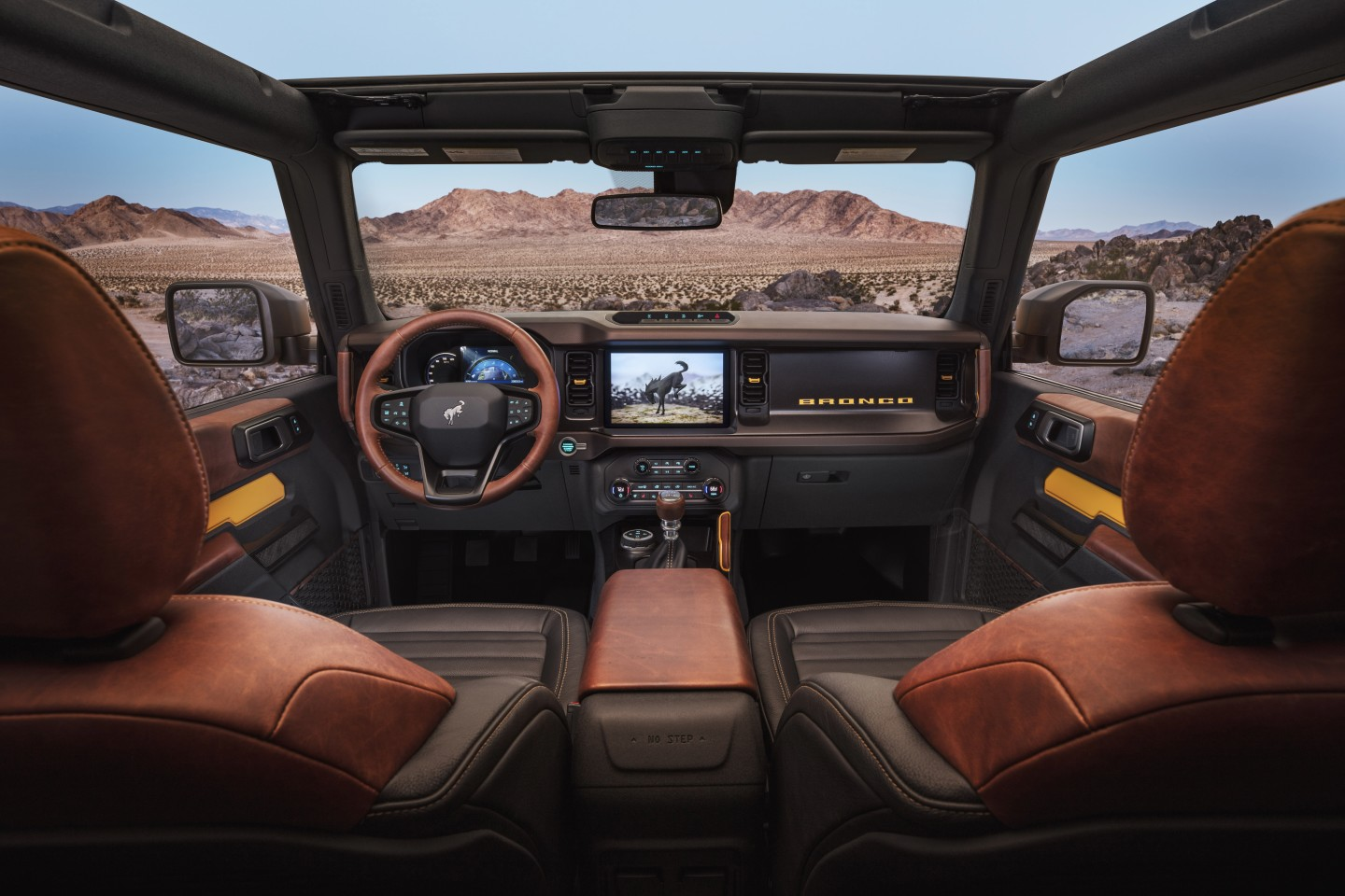 The 2021 Bronco will offer an available 12-inch SYNC 4 system, optional leather trim seating, console-mounted transmission shifter/selector and G.O.A.T. Modes control knob