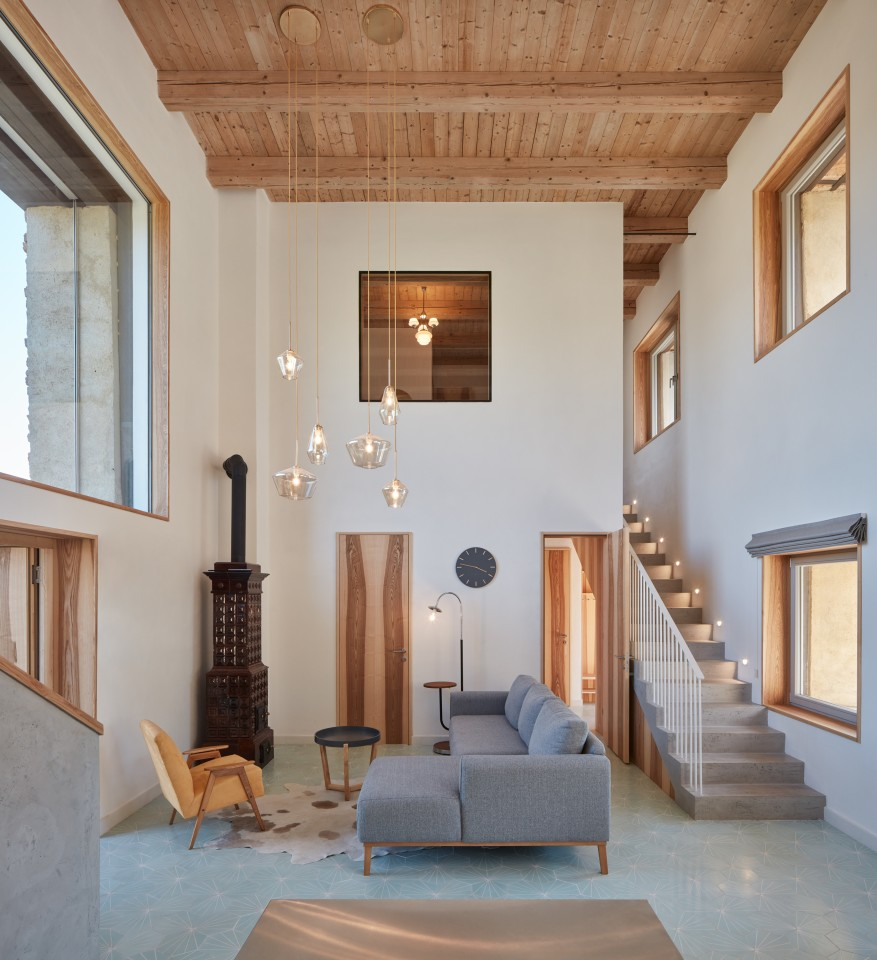 House Inside a Ruin's interior measures 248 sq m (around 2,600 sq ft) and is centered around a double-height living area