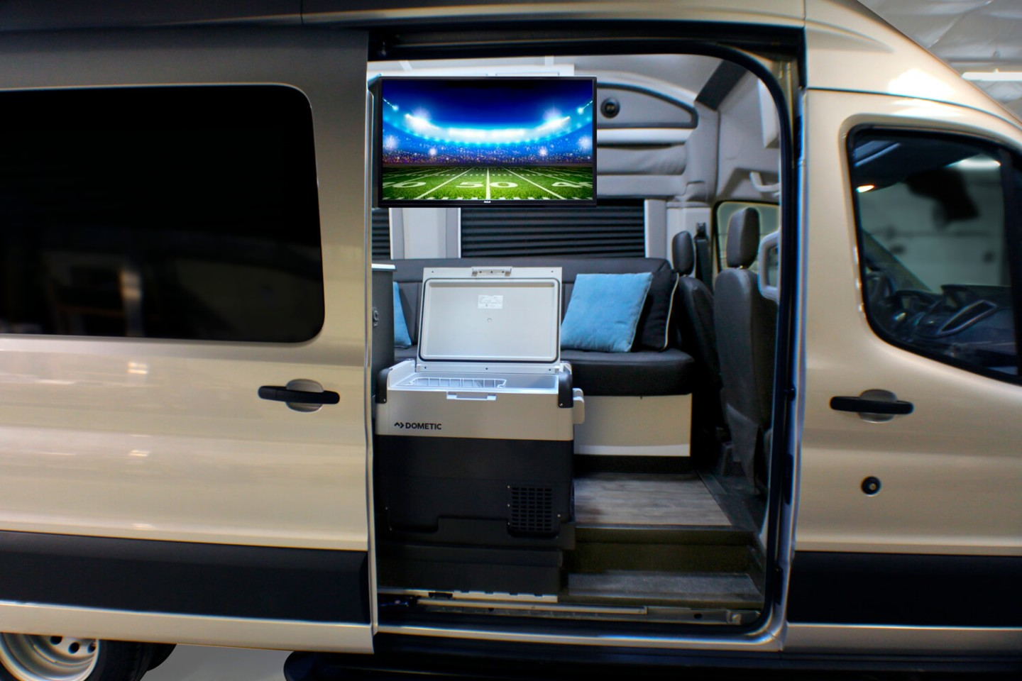 Swing the fridge and TV around, and you have a game day tailgate area or movie night nook