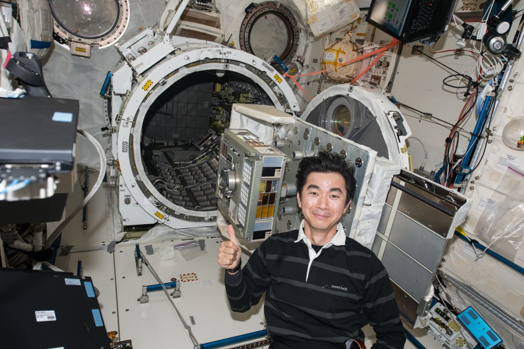 A Japanese astronaut sets up the experiment onboard the International Space Station