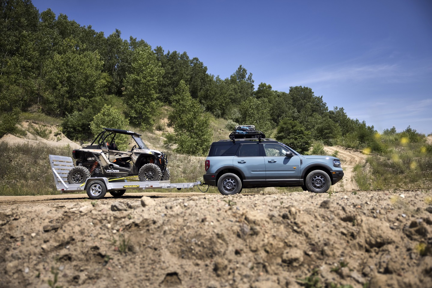 Two icons of off-roading: Ford Bronco (Sport) and Polaris RZR (XP Turbo 1000)