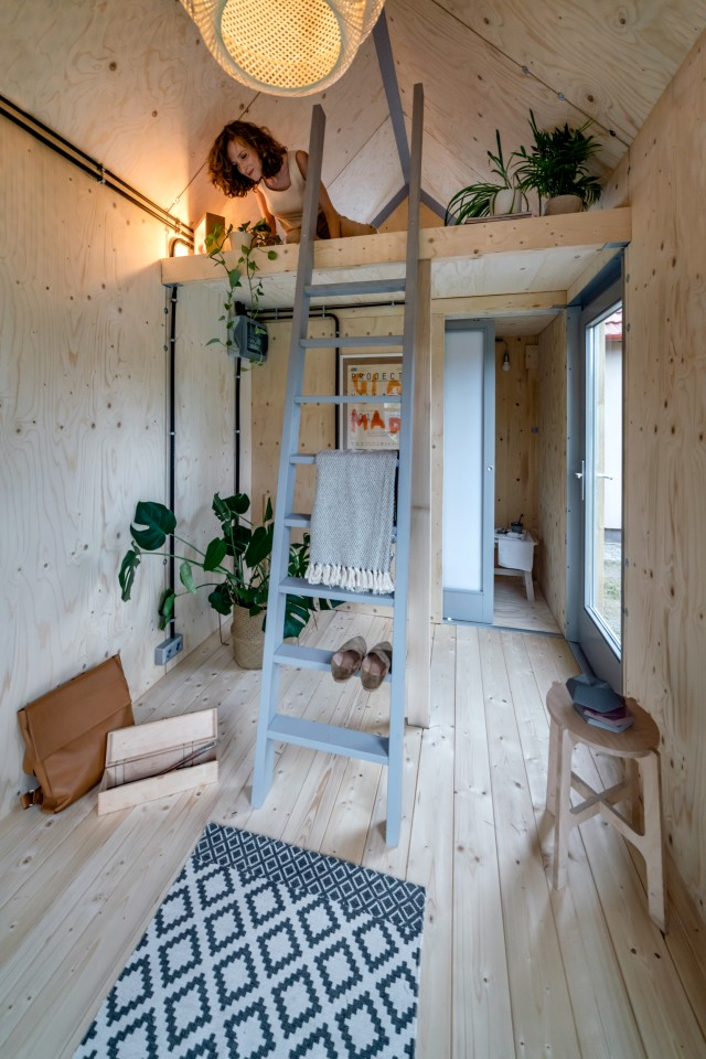 The Kabinka features a typical tiny house-style bedroom that's reached by ladder