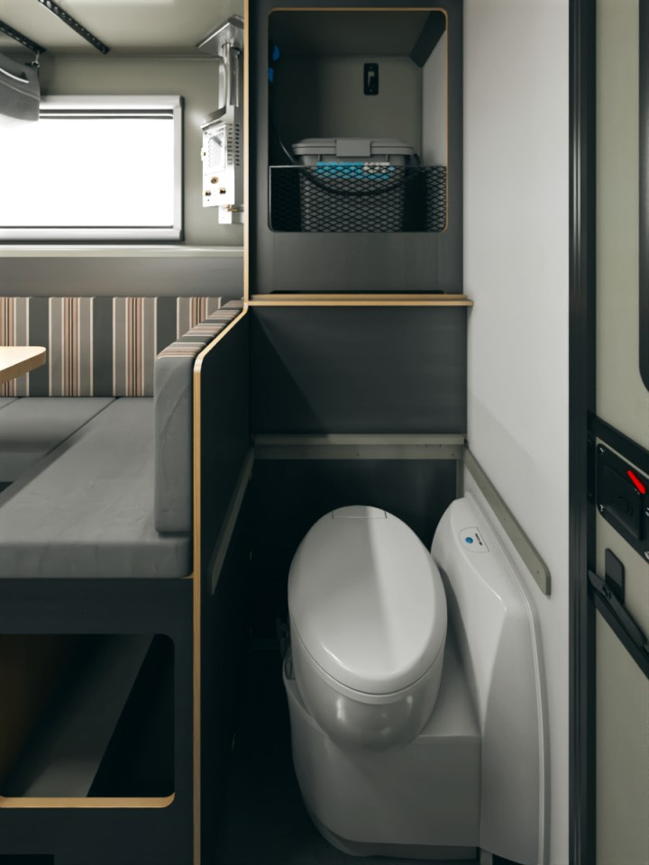 The available toilet tucks away to the right of the entry; the RinseKit shower stores on the shelf behind it; and a curtain closes around the shower pan in the entryway to create a functional wet bathroom