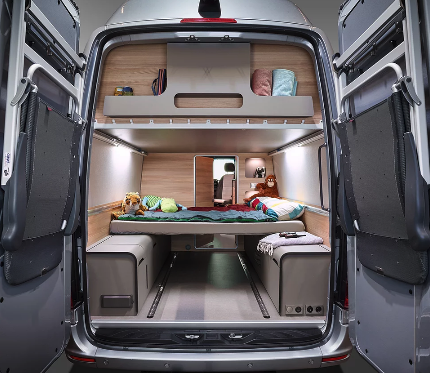 The Alphavan turns into a family camper with the addition of the folding rear bed(s), turning the FlexPort into a kids' room