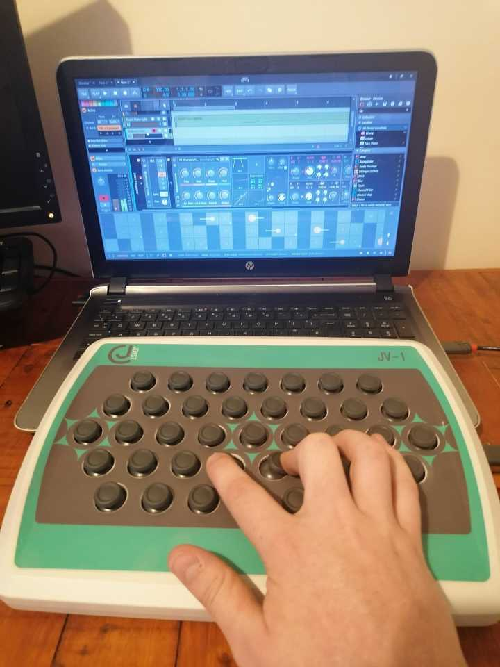 The JV-1 MIDI controller can be cabled to a laptop running music production software over USB