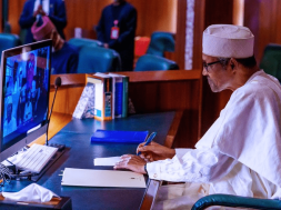 President Muhammadu Buhari seen in picture on desktop computer