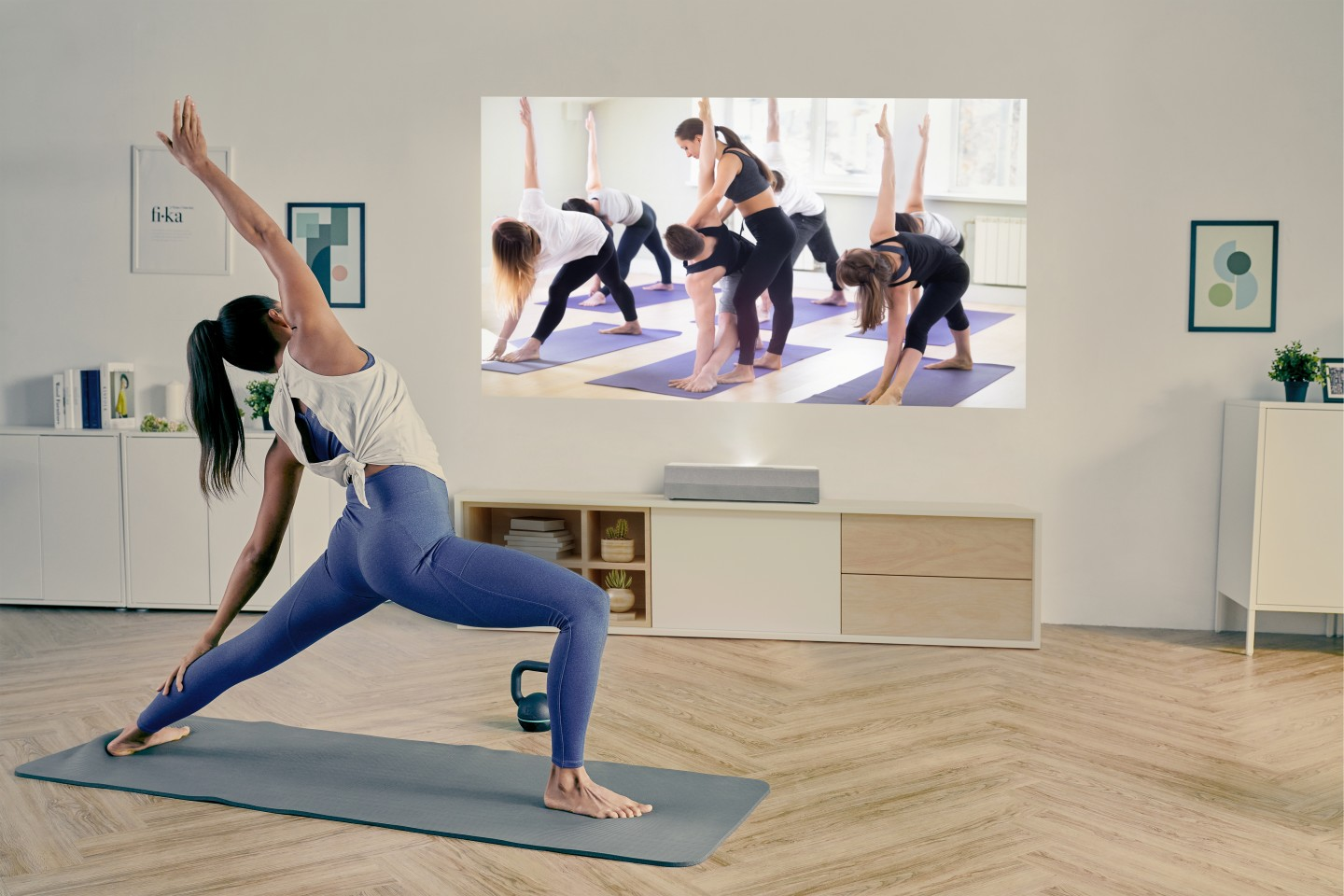 The CinemaX P2 can mirror content from a smartphone, such as a streamed yoga lesson