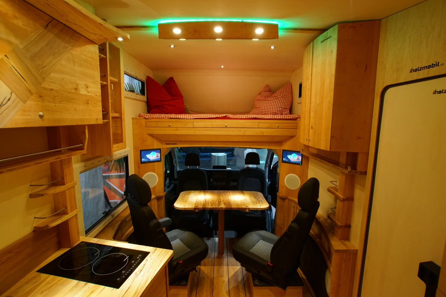 The 4,500-kg Holzmobil has a sleeper alcove and four-chair dining area