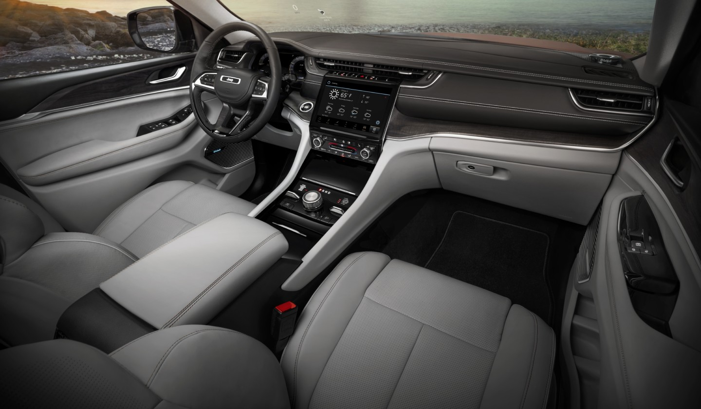 Jeep brings the latest tech to the interior of the Grand Cherokee L, including a frameless digital gauge cluster and pictured 10.1-in Uconnect 5 touchscreen infotainment system