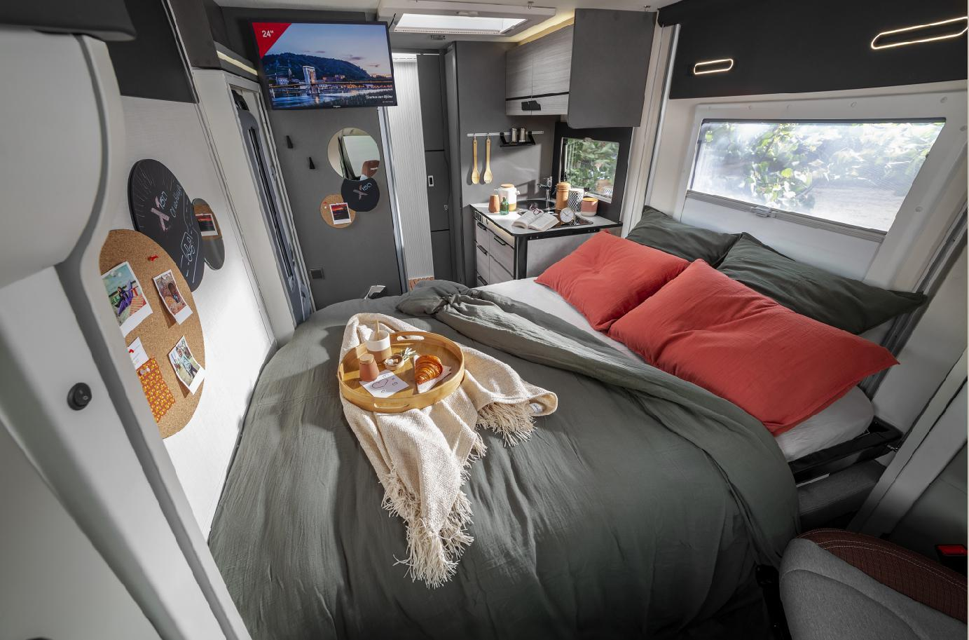 Drop the single bed down for two people or raise it a little and convert the dining lounge furniture into a second bed