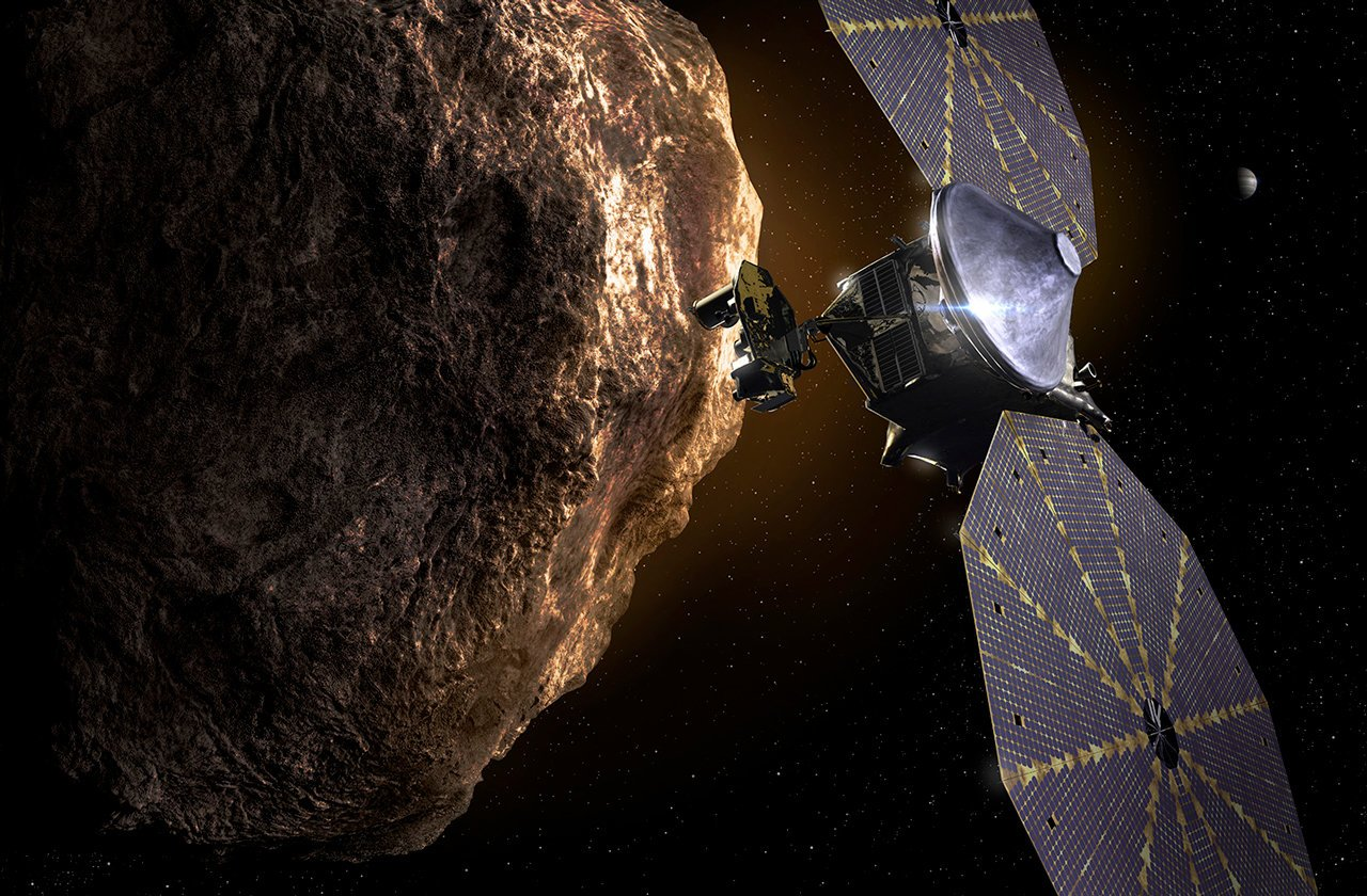An artist's impression of Lucy performing a close flyby of an asteroid