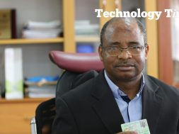 Engineer Aliyu Abubakar Aziz, Director General/CEO of National Identity Management Commission (NIMC), seen holding a National ID card during the interview with Technology Times at the NIMC Headquarters in Abuja