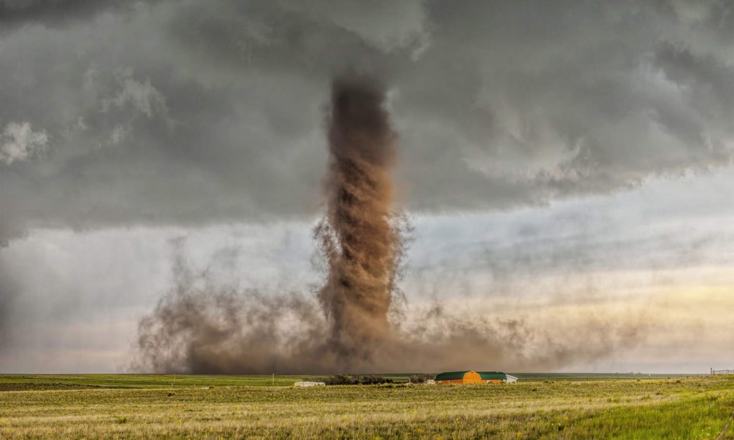 """Australia's James Smart found himself in Colorado as this """"drill bit"""" tornado touched down, ripping up soil to give it an earthy color"""