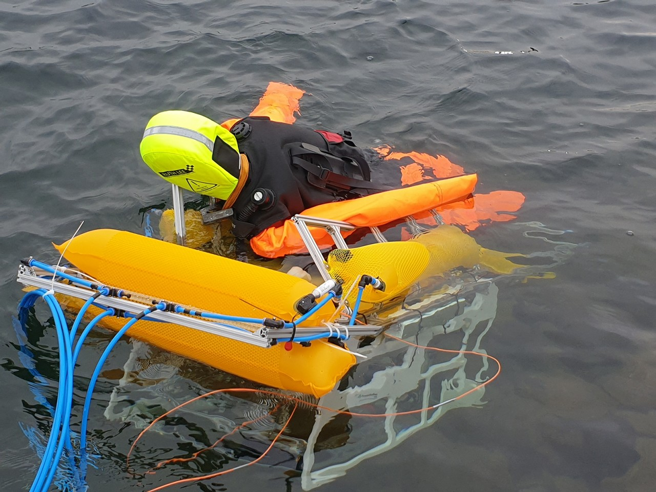 The robot transports the dummy to shore