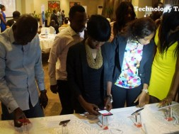 People seen testing mobile phones at a launch event in Lagos, one of the biggest phone markets in Nigeria