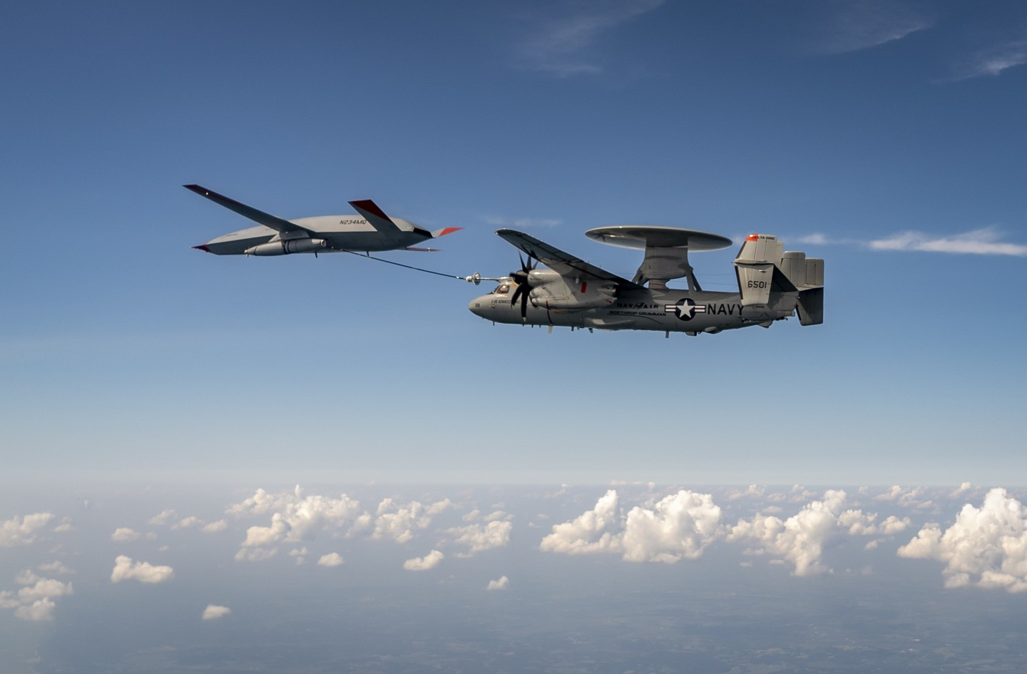 The flight test studied how the Hawkeye handled the Stingray's engine wake